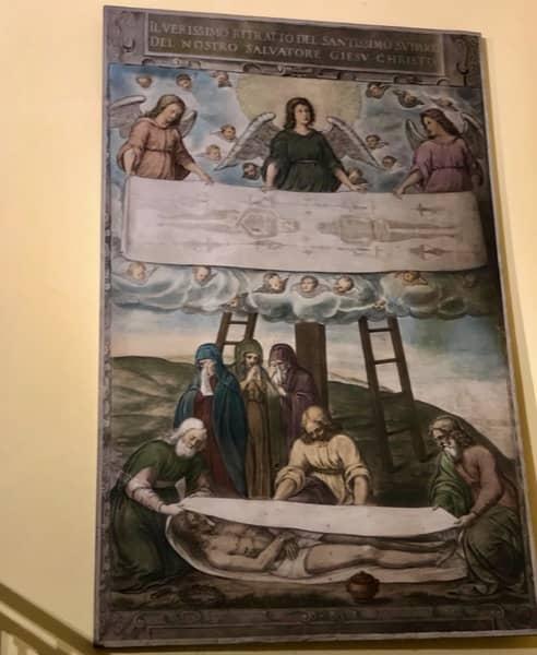 Plakat przedstawiający zdjęcie z krzyża Chrystusa i owinięcie Go w prześcieradło, Całun Turyński